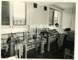 Student  in a laboratory at UCWI, Mona.