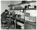 Man with scientific instrument in a lab at UWI, Mona.