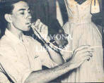 St. Lucia - young man attempts to smoke an abnormally long cigarette